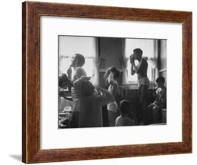 Professional Couple's Big Family, Sharing the Only Bathroom, Early in the Morning-Gordon Parks-Framed Premium Photographic Print