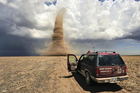 Professional Storm Chasers Monitor an Approaching Tornado-Jim Reed-Photographic Print