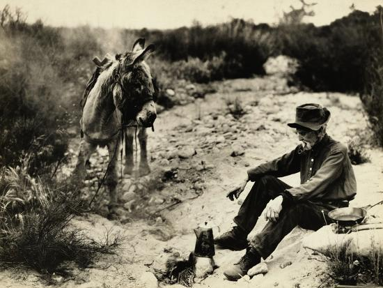 Prospector Preparing Meal for Himself--Photographic Print