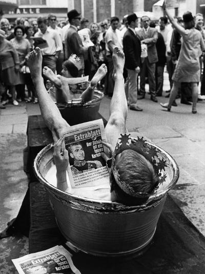 "Protesters Sit in Bath Tubs and Read the Satirical Newspaper ""Pardon""--Photographic Print"