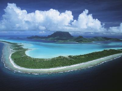 Puffy Clouds Fill the Sky over a Cluster of Polynesian Islands-Tim Laman-Photographic Print