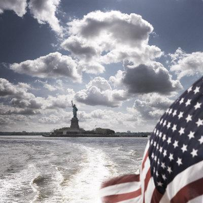 View of Statue of Liberty from Rear of Bot with Stars and Stripes Flag, New York