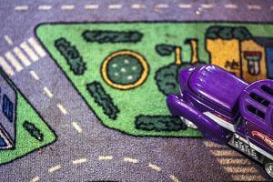 Purple Toy Car on Street Mat