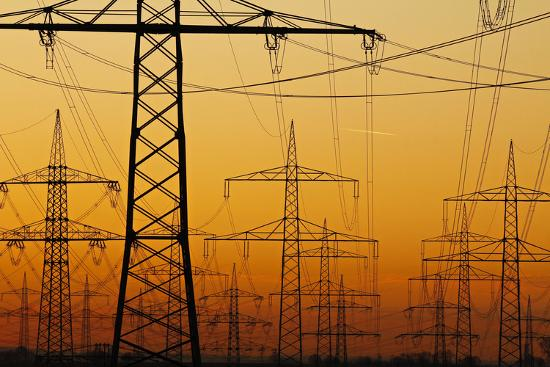 Pylons and power lines in morning light, Germany, Europe-Hans-Peter Merten-Photographic Print