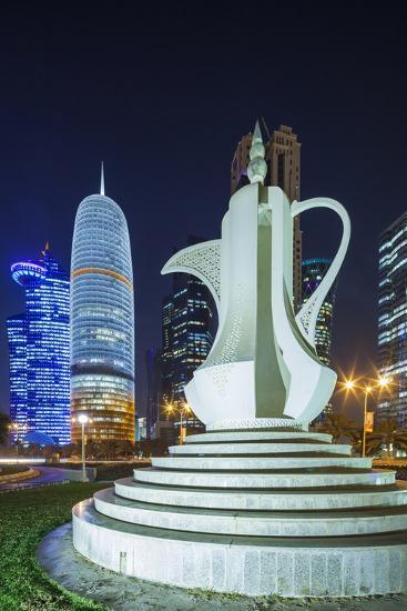Qatar, Doha, Doha Bay, West Bay Skyscrapers, Dusk, with Large Coffeepot Sculpture-Walter Bibikow-Photographic Print