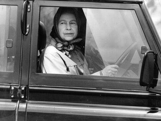 Queen Elizabeth II at the wheel of her Land Rover-Associated Newspapers-Photo