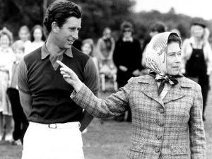 Queen Elizabeth II Shows Prince Charles Sign at a Polo Match at Windsor Great Park Points Finger