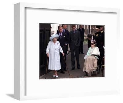 Queen Mother waves on her 101 birthday watched by Princess Margaret in wheelchair and Prince Charle