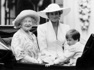 Queen Mother with Princess Diana and Prince William in an open carriage