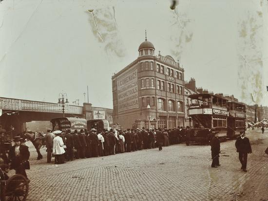 Queue of people at a bus stop in the Blackfriars Road, London, 1906-Unknown-Photographic Print