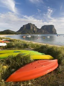 Canoes and Kayaks Lining Lagoon Beach with Mt Gower and Mt Lidgbird in Distance by Rachel Lewis