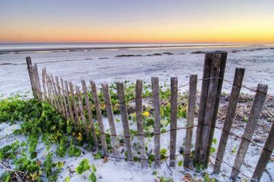 A Beach Fence at Sunset on Hilton Head Island, South Carolina. by Rachid Dahnoun