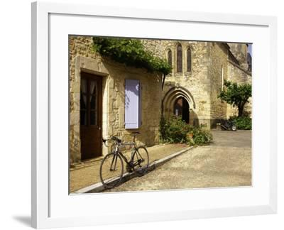 Racing Bike Parked in Street of Village of Daglan-Barbara Van Zanten-Framed Photographic Print