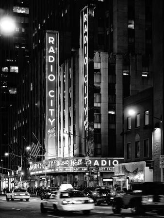 https://imgc.artprintimages.com/img/print/radio-city-music-hall-and-yellow-cab-by-night-manhattan-times-square-nyc-usa_u-l-pz22a90.jpg?p=0