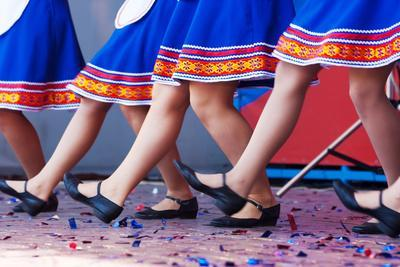 Russian Girls in Traditional Costumes Dancing on Stage. Legs Closeup