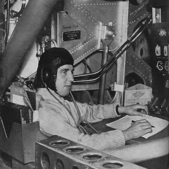 RAF flight engineer on board an aircraft, c1940 (1943)-Unknown-Photographic Print