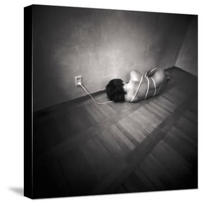 A Naked Woman Tied with Electric Flex Lying on the Floor of a Room