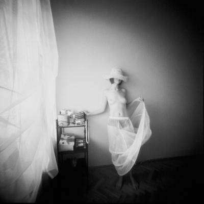 Pinhole Camera Shot of Standing Topless Woman in Hoop Skirt