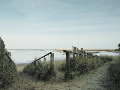 Railing Converging on a Beach--Photographic Print