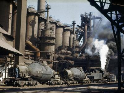 https://imgc.artprintimages.com/img/print/railroad-containers-line-up-to-take-molten-iron-from-blast-furnaces_u-l-p8bjrj0.jpg?p=0