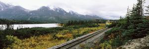 Railroad Track Passing through a Landscape, Yukon Railroad, Summit Lake, White Pass, Alaska, USA