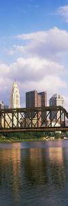 Railway bridge across a river with skyscrapers in the background, Scioto River, Columbus, Ohio, USA