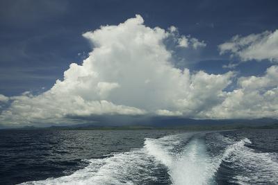 Rain Clouds over the Village of Labilabi on Halmahera Island-Timothy Laman-Photographic Print