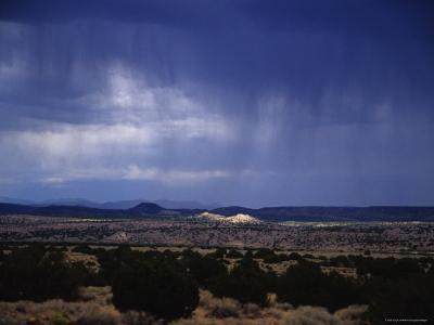Rain Pores Down on the Desert Landscape in New Mexico-Stacy Gold-Photographic Print