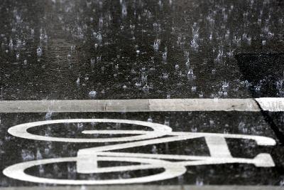 Rain Pours onto a Bicycle Lane-Maurizio Gambarini-Photographic Print