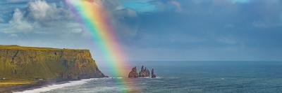 Rainbow over basalt sea stacks, Iceland--Photographic Print