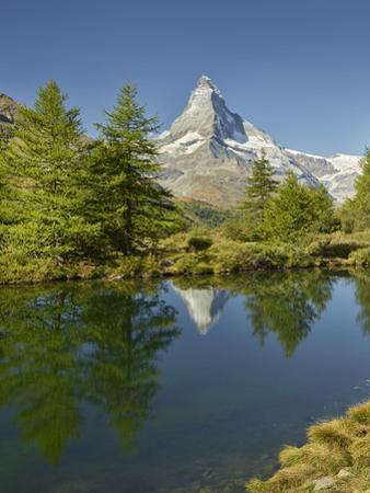 A Person, Grindjisee, Matterhorn, Zermatt, Valais, Switzerland by Rainer Mirau