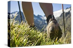 Austria, Tyrol, Oetztal Alps, Obergurgl, Close-Up of Woman Hiking in Mountains by Rainer Mirau