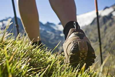 Austria, Tyrol, Oetztal Alps, Obergurgl, Close-Up of Woman Hiking in Mountains