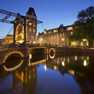 Doelen Hotel, Kloveniersburgwal, Lights, Reflexion, in the Evening, Amsterdam, the Netherlands by Rainer Mirau
