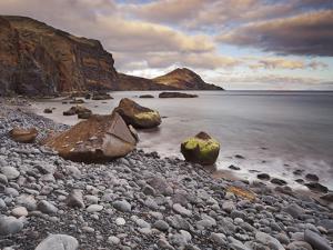 Stones on the Beach of Baja D'Abra, Sao Lourenco Peninsula, Madeira, Portugal by Rainer Mirau