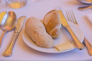 Table Set, Cutlery, Bread Roll, Butter by Rainer Mirau