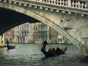 Gondola under the Rialto Bridge on the Grand Canal in Venice, Veneto, Italy by Rainford Roy