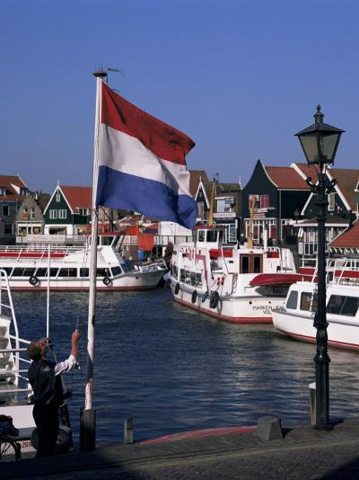 Raising the Dutch Flag by the Harbour, Volendam, Ijsselmeer, Holland-I Vanderharst-Photographic Print