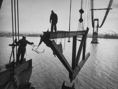 Raising the Truss, Men of the Raising Gang Ride the Swinging Steel 160 Feet Above the Water-Peter Stackpole-Photographic Print