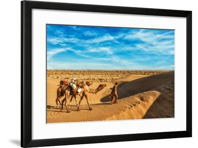 Rajasthan Travel Background - India Cameleer (Camel Driver) with Camels in Dunes of Thar Desert. Ja-DR Travel Photo and Video-Framed Photographic Print