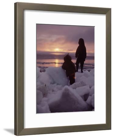 Alaska: Silhoutte of Native Alaskan Children Watching the Midnight Sun