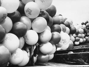 Balloons Lying on Ground Prior to Release by Ralph Crane