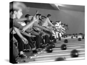 Boys Competing in Junior League Bowling Game by Ralph Crane