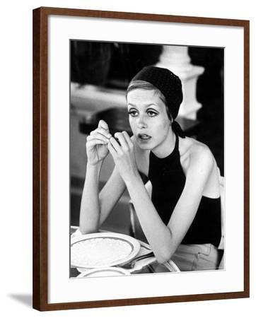 British Fashion Model Twiggy with Slumpy Posture, at Table in Restaurant at Disneyland