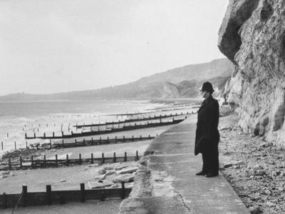 British Police Officer Standing at Foot of Dover Cliffs, Path for Proposed Dover-Calais Tunnel