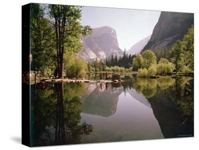 Children on Rocks on Mirror Lake in Yosemite National Park with Mountain Rising in the Background
