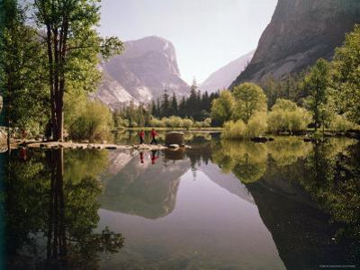 Children on Rocks on Mirror Lake in Yosemite National Park with Mountain Rising in the Background by Ralph Crane