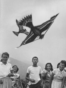 Children Playing with Various Flying Toys by Ralph Crane