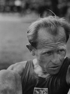Emil Zatopek Sitting Tensely with Furrowed Brow after Winning Second of Three Olympic Races by Ralph Crane
