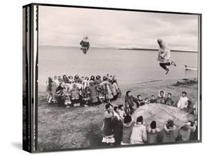 Eskimos Using Homemade Trampolines to Celebrate the End of Whaling Season by Ralph Crane
